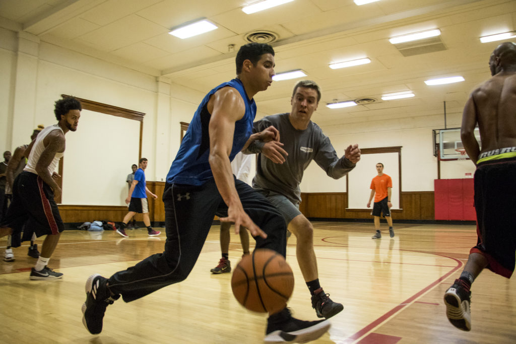 Jovan Robinson dribbles with gusto during a pick-up basketball game at the Twentieth Street Recreation Center downtown, Oct. 16, 2018. (Kevin J. Beaty/Denverite)