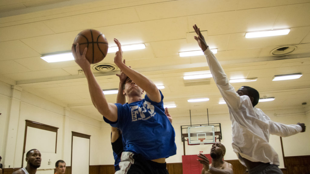 Bryce Hentges leaps for a basket during a pick-up basketball at the Twentieth Street Recreation Center downtown, Oct. 16, 2018. (Kevin J. Beaty/Denverite)