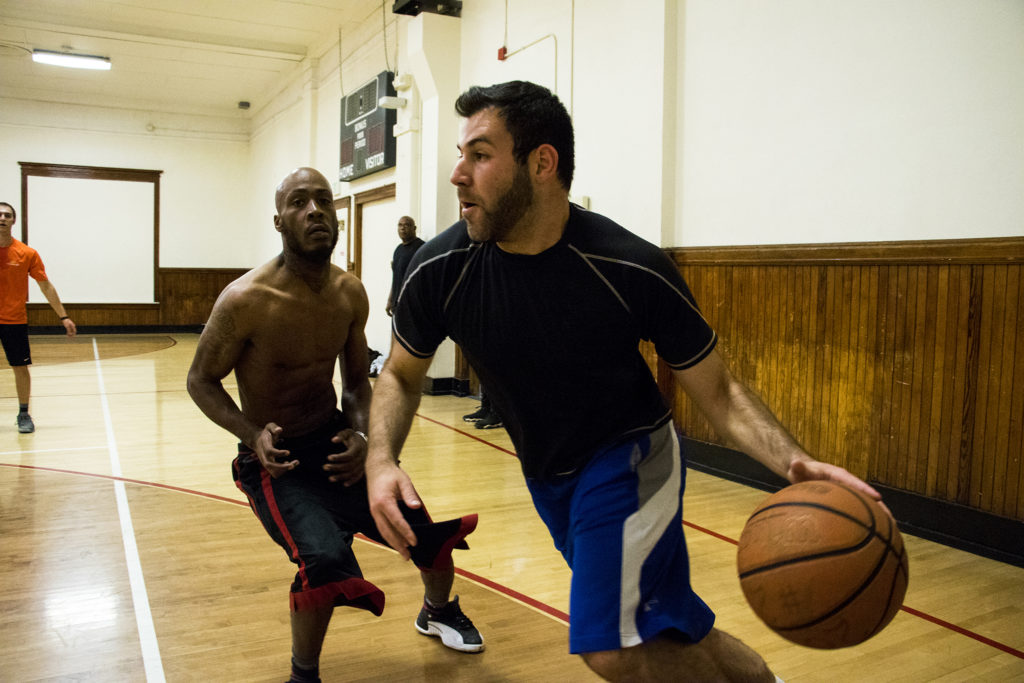 Andrew Bennett drives for a basket during a pick-up game at the Twentieth Street Recreation Center downtown, Oct. 16, 2018. (Kevin J. Beaty/Denverite)