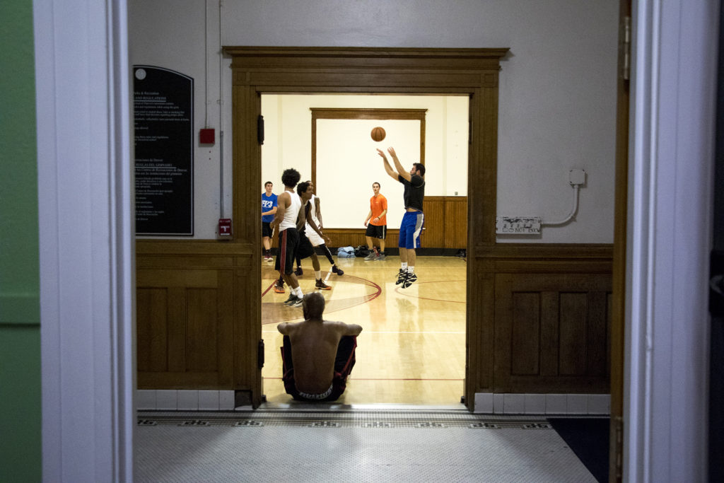 Andrew Bennett leaps for a basket during a pick-up game at the Twentieth Street Recreation Center downtown, Oct. 16, 2018. (Kevin J. Beaty/Denverite)