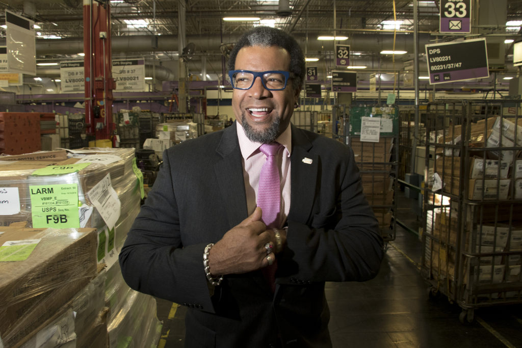 Denver Elections spokesman Alton Dillard poses for a portrait at the U.S. Postal Service's massive sorting and shipping facility in Stapleton as ballots are shipped out to voters, Oct. 16, 2018. (Kevin J. Beaty/Denverite)