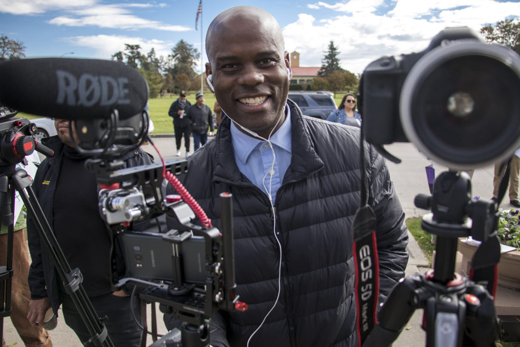 Brother Jeff Fard documents Lisa Calderón's first rally after announcing she would run for Denver mayor, Oct. 17, 2018. (Kevin J. Beaty/Denverite)