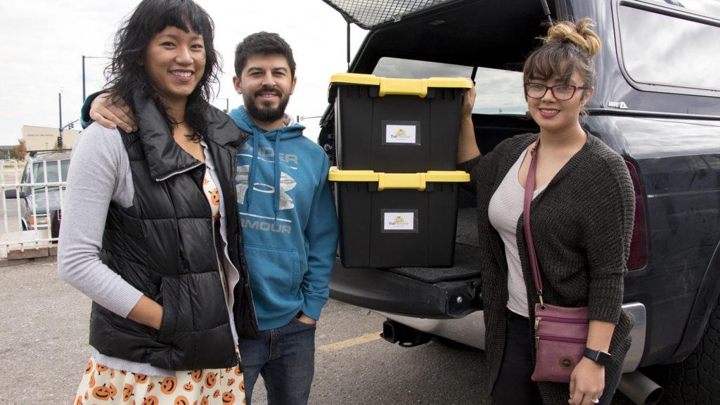FairMeadow laundry service's Khara and Javier Muniz (left to right) and Linda Vasquez pose for a portrait, Oct. 17, 2018. (Kevin J. Beaty/Denverite)
