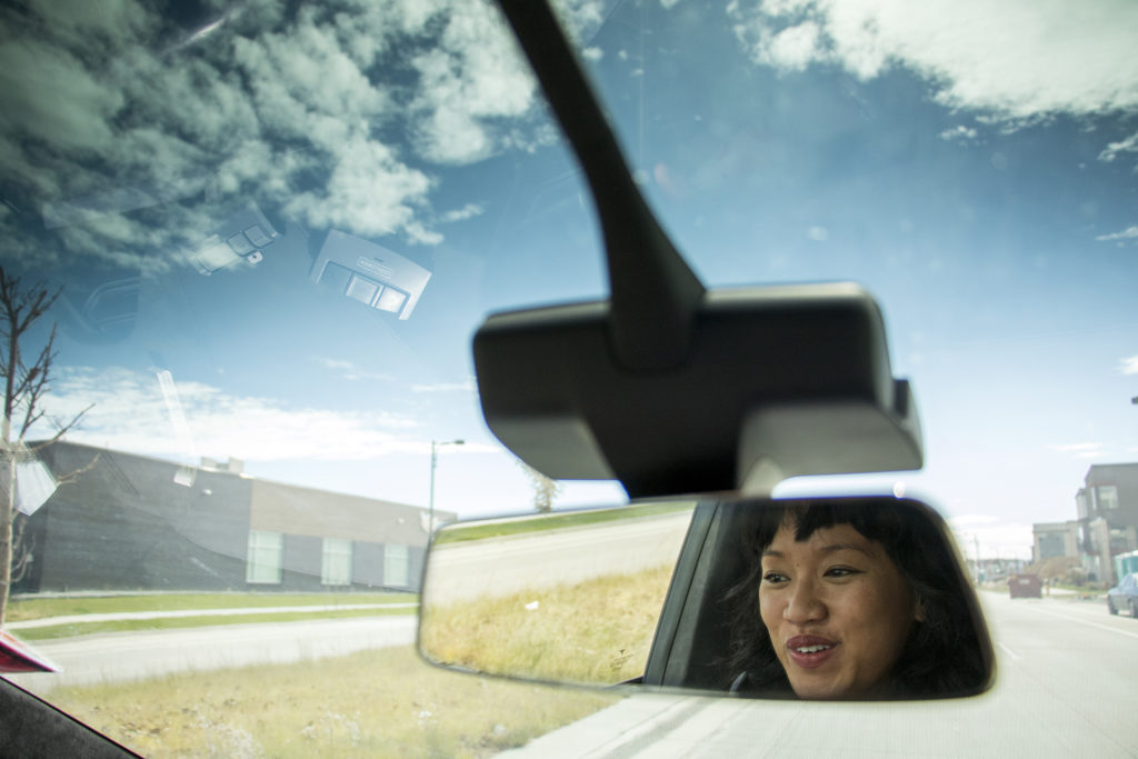FairMeadow laundry service co-founder Khara Muniz drives on a delivery mission, Oct. 17, 2018. (Kevin J. Beaty/Denverite)