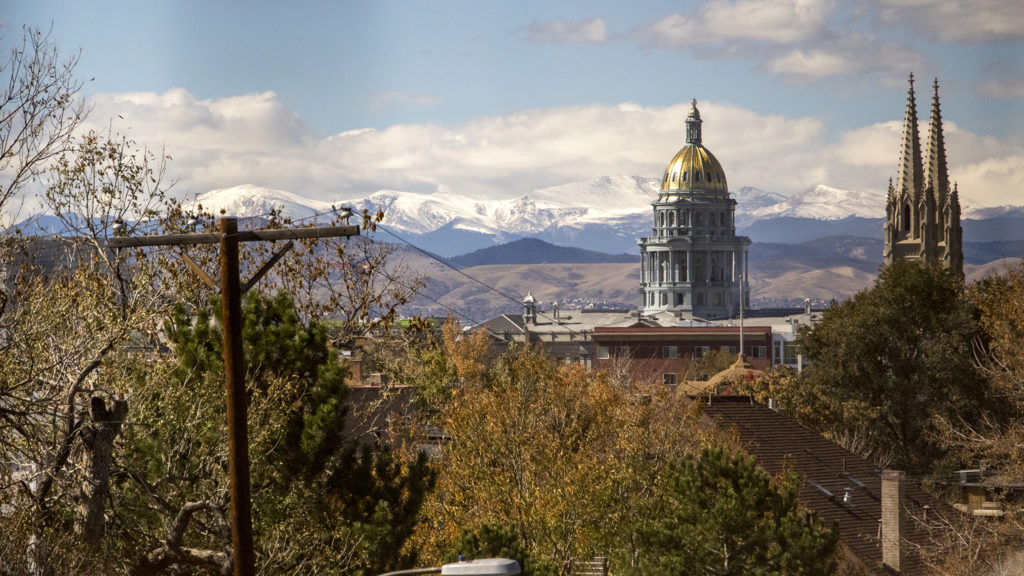 A view of the Capitol and the Cathedral Basilica of the Immaculate Conception from 16th Avenue and Downing Street, Oct. 18, 2018. (Kevin J. Beaty/Denverite)