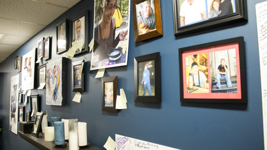 A wall of portraits of Dry Bones Denver members who have passed away inside their City Park West headquarters, Oct. 18, 2018. (Kevin J. Beaty/Denverite)