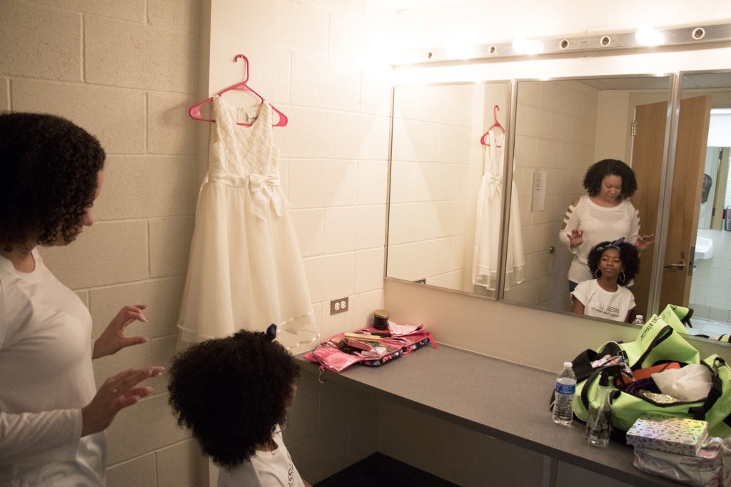 Skye Kelley helps her daughter, Lola (12), prepare for Curls on the Block's second-annual Miss Curly Pageant. Collegiate Prep Academy, Montbello, Oct. 21, 2018. (Kevin J. Beaty/Denverite)