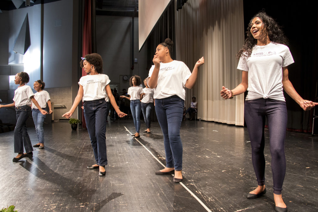 Contestants in the second-annual Miss Curly Pageant perform as the program opens. Collegiate Prep Academy, Montbello, Oct. 21, 2018. (Kevin J. Beaty/Denverite)