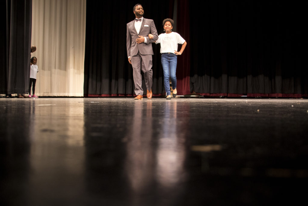 Ryomi (11) walks onstage during Curls on the Block's second-annual Miss Curly Pageant. Collegiate Prep Academy, Montbello, Oct. 21, 2018. (Kevin J. Beaty/Denverite)