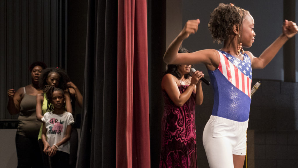 Naylani (10) flexes during Curls on the Block's second-annual Miss Curly Pageant. Collegiate Prep Academy, Montbello, Oct. 21, 2018. (Kevin J. Beaty/Denverite)
