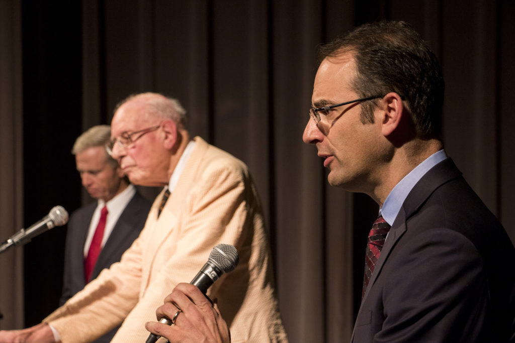 Republican George Brauchler (left to right), Libertarian William F. Robinson and Democrat Phil Weiser debate as candidates for Colorado Attorney General, Oct. 23, 2018. (Kevin J. Beaty/Denverite)