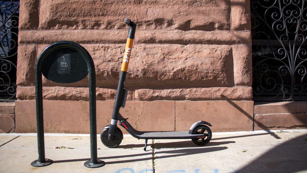 Spin scooters on the street downtown, Oct. 23, 2018. (Kevin J. Beaty/Denverite)