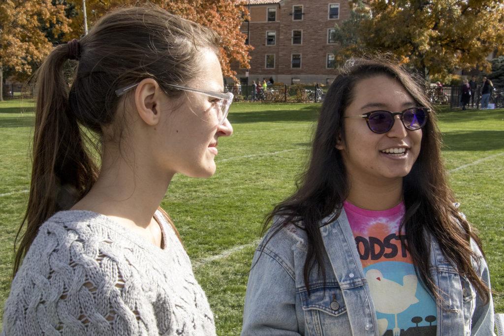 Cara Allen (left) and Maya Shrestha speak to a reporter after Bernie Sanders spoke on CU Boulder's campus, Oct. 24, 2018. (Kevin J. Beaty/Denverite)