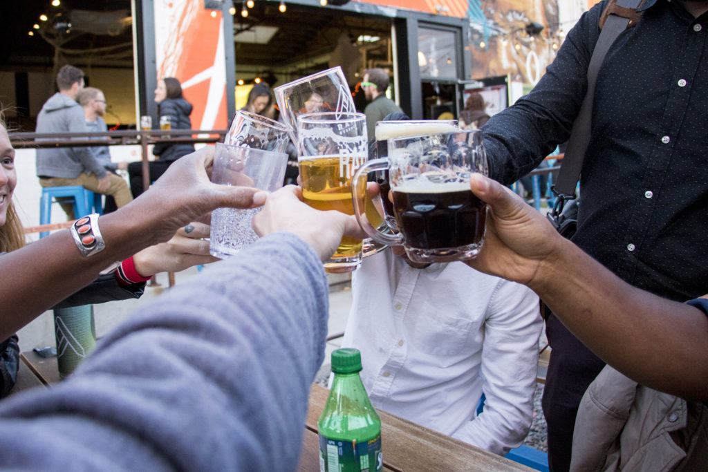 Cheers with mostly beers, celebrating the exciting conclusion of the Great Denver Transportation Race, Oct. 25, 2018. (Kevin J. Beaty/Denverite)
