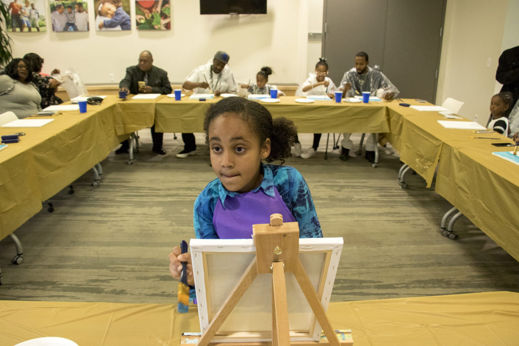 Rory (7) leads a painting class during A Father Daughter Occasion at the Dahlia Campus for Health and Well-Being in Northeast Park Hill, Oct. 27, 2018. (Kevin J. Beaty/Denverite)