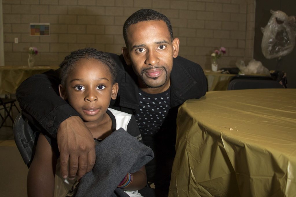 Steve Griffin poses with his daughter, Jailah (6). A Father Daughter Occasion at the Dahlia Campus for Health and Well-Being in Northeast Park Hill, Oct. 27, 2018. (Kevin J. Beaty/Denverite)