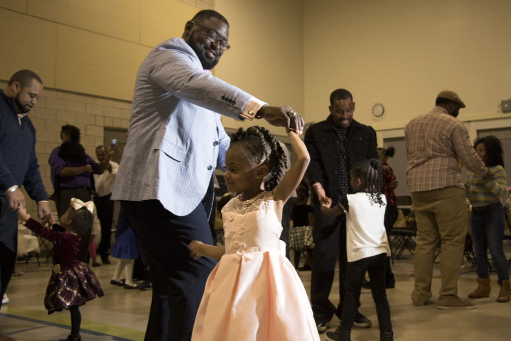 Ryan Ross dances with his daughter, Zoe (3). A Father Daughter Occasion at the Dahlia Campus for Health and Well-Being in Northeast Park Hill, Oct. 27, 2018. (Kevin J. Beaty/Denverite)