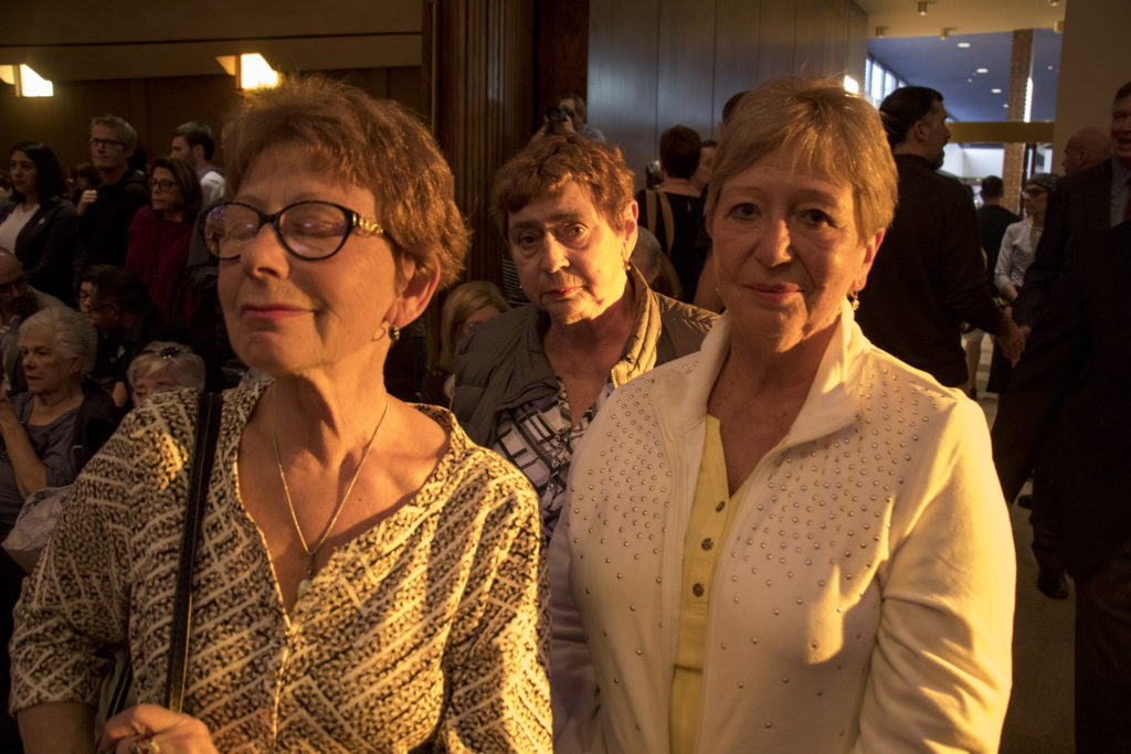 Galena Kirzner (left to right), Mayi Gurevch and Alla Shcherbiwa await a vigil at Temple Emanuel to begin for the victims in a mass shooting at a Pittsburgh synagogue, Oct. 28, 2018. (Kevin J. Beaty/Denverite)