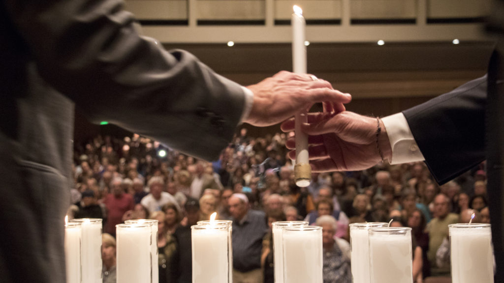 Dignitaries light candles for a victims of a mass shooting at a Pittsburgh synagogue during a vigil at Temple Emanuel, Oct. 28, 2018. (Kevin J. Beaty/Denverite)