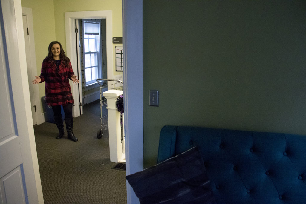 Katelyn Puga gives a tour of her family's old home in the Auraria Ninth Street Historic District, Oct. 30, 2018. (Kevin J. Beaty/Denverite)