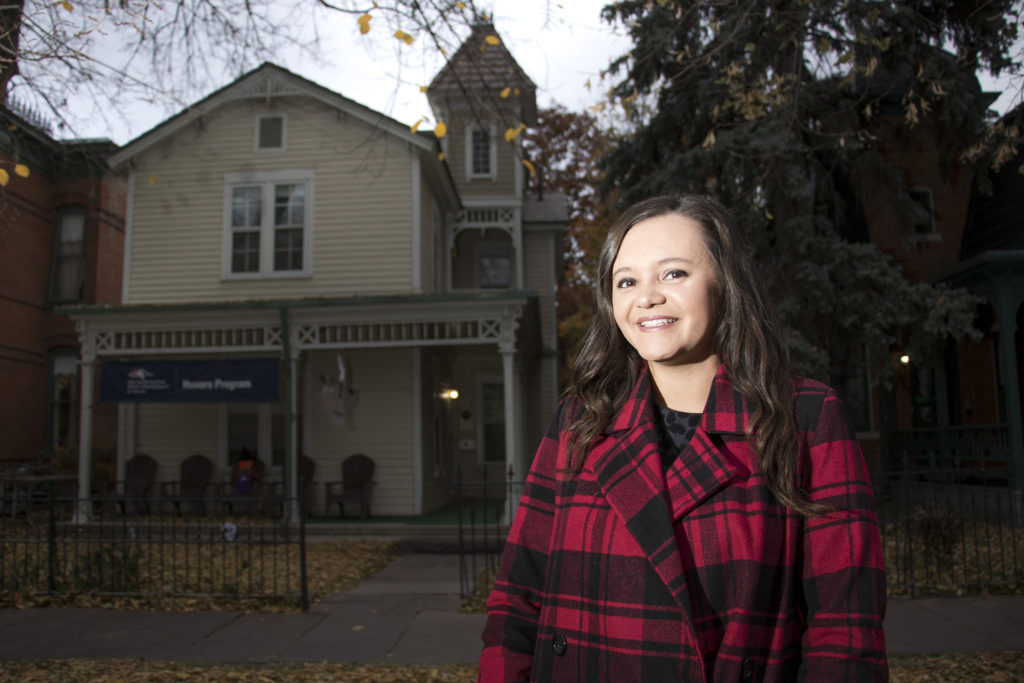 Katelyn Puga poses for a portrait in front of her family's old home in the Auraria Ninth Street Historic District, Oct. 30, 2018. (Kevin J. Beaty/Denverite)