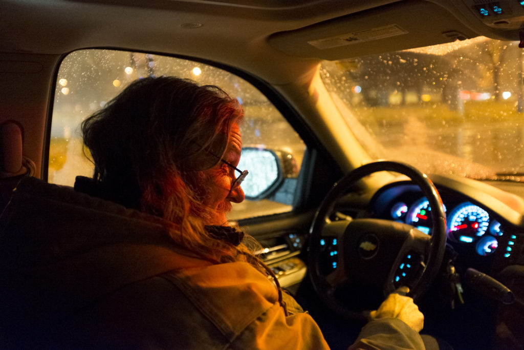John Jenkins drives the Salvation Army's nightly search and rescue service to check on people sleeping on the street, Oct. 30, 2018. (Kevin J. Beaty/Denverite)