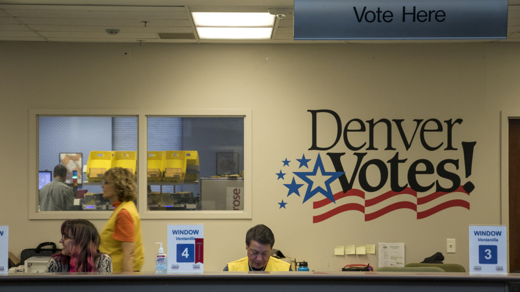 Workers at Denver Elections Division headquarters are ready for voters, Oct. 31, 2018. (Kevin J. Beaty/Denverite)