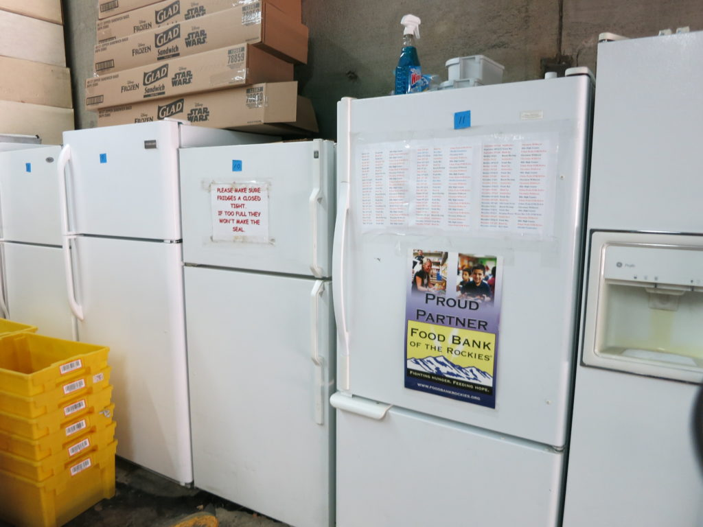 A row of refrigerators in the warehouse where Jim Scharper stages food handouts for his nonprofit Feeding Denver's Hungry. (Donna Bryson/Denverite)
