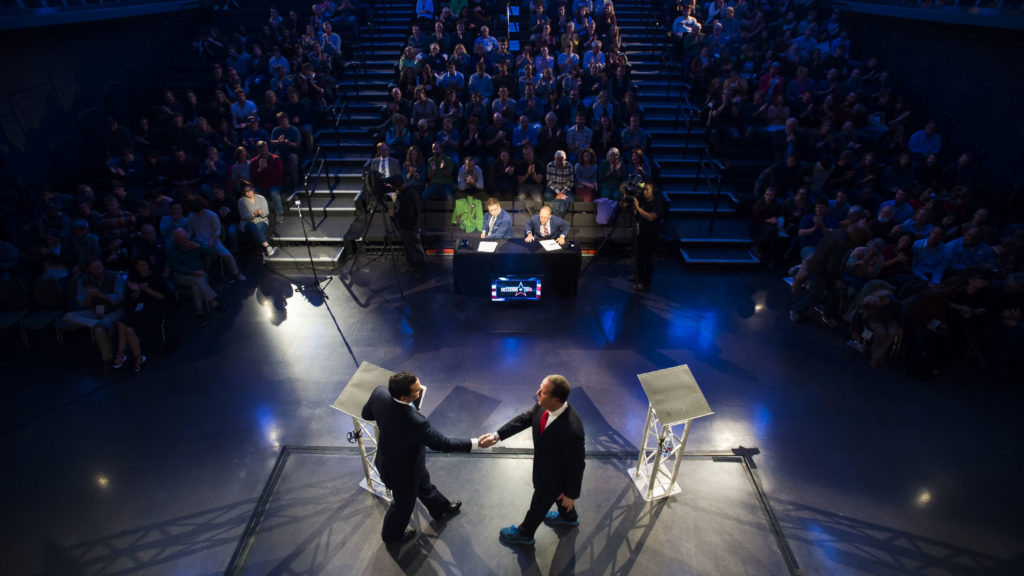 Democratic candidate for Colorado governor Jared Polis, right, and Republican candidate for Colorado governor Walker Stapleton shake hands after participating in a debate on Wednesday, Oct. 17, 2018, at the Lory Students Center on Colorado State University's campus in Fort Collins, Colo. (Timothy Hurst/The Coloradoan)