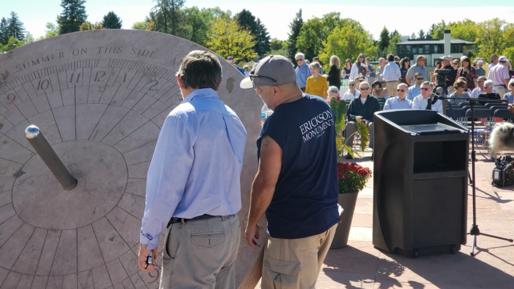 Crowd gathers as people take a look at the recently completed sundial at Cranmer Park. (Allan Tellis/ Denverite)