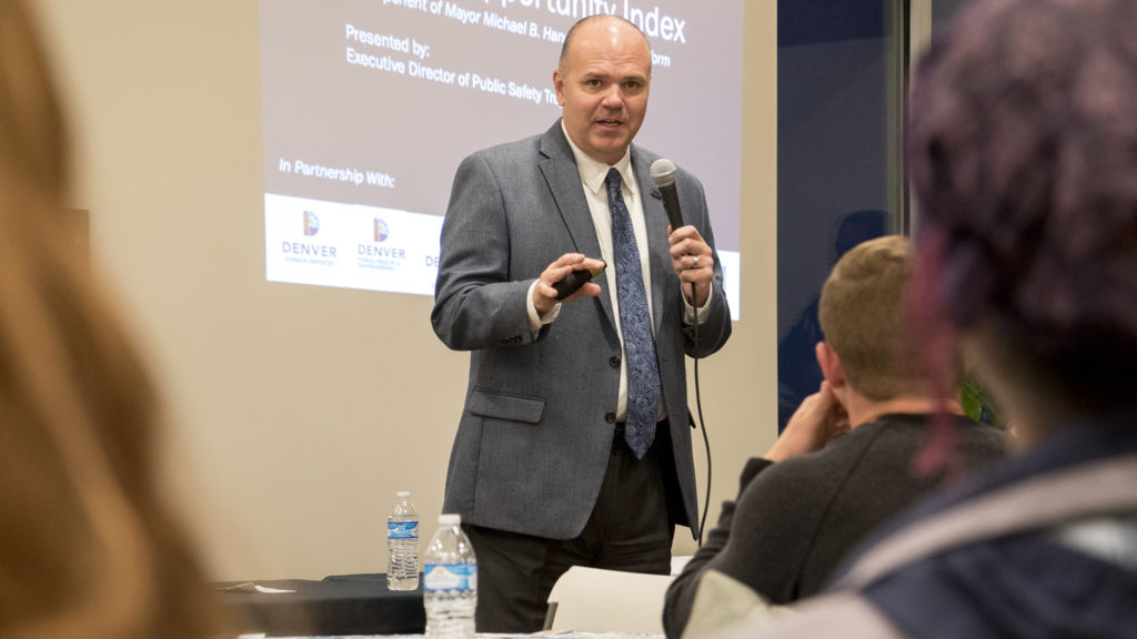 """Denver Department of Safety Director Troy Riggs speaks to a crowd at the St. John's Apartments about the city's new """"Opportunity Index,"""" Oct. 30, 2018. (Kevin J. Beaty/Denverite)"""