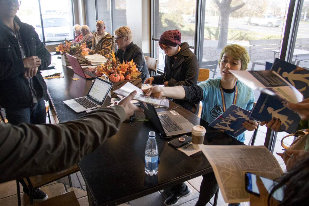 CIRC Action Fund field manager Kimmy Fry hands out canvassing materials inside a Westminster Starbucks that has become a de facto political field office, Nov. 1, 2018. (Kevin J. Beaty/Denverite)