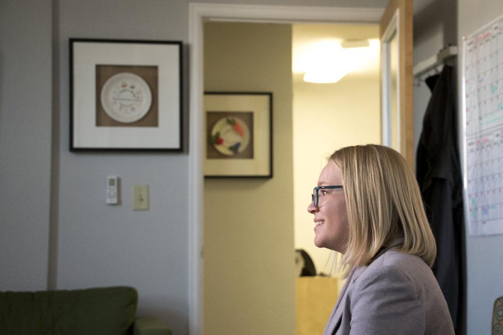 Ellie Agar, interim director of communications for Hunger Free Colorado, speaks to a reporter. Nov. 7, 2018. (Kevin J. Beaty/Denverite)