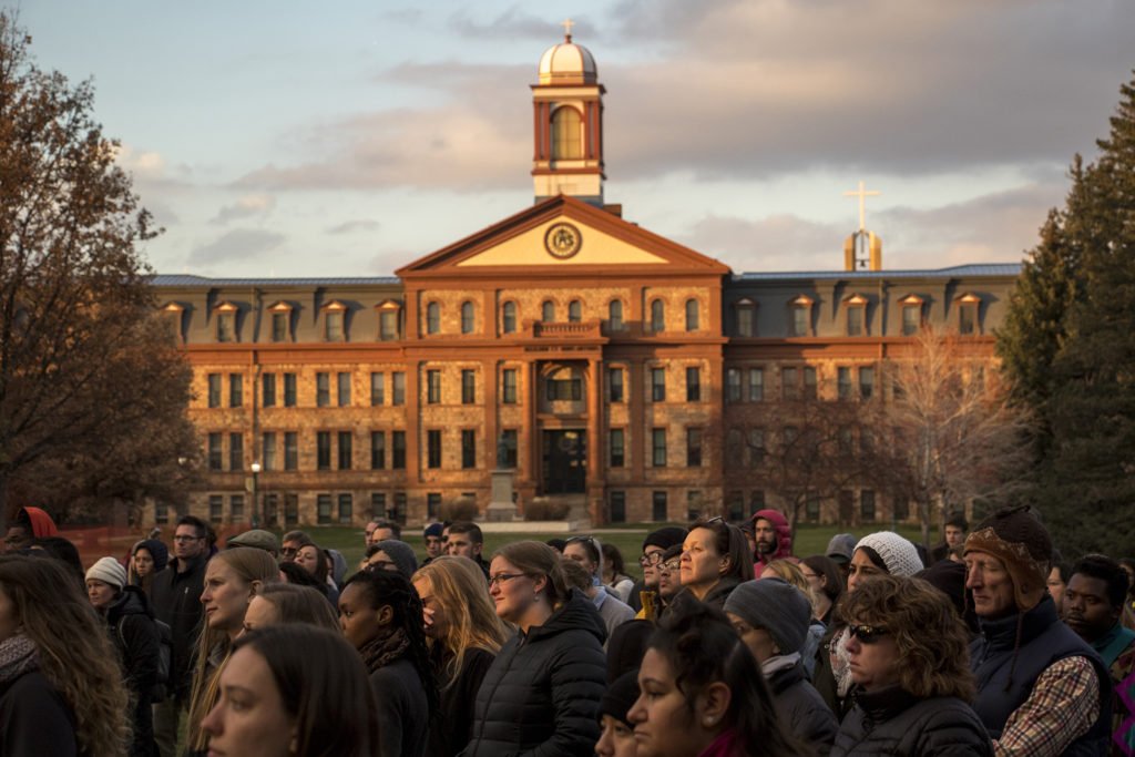 Students and faculty at Regis University gather to denounce an incident of hate speech on campus, Nov. 7, 2018. (Kevin J. Beaty/Denverite)