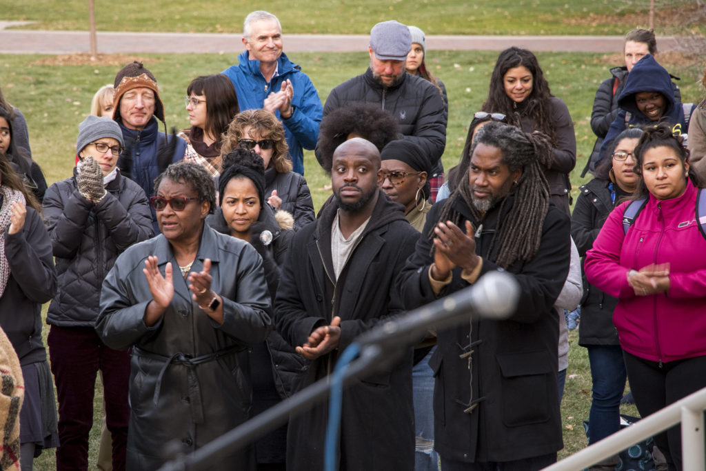 Jumoke Emery-Brown (center) was present at the vigil. Students and faculty at Regis University gather to denounce an incident of hate speech on campus, Nov. 7, 2018. (Kevin J. Beaty/Denverite)
