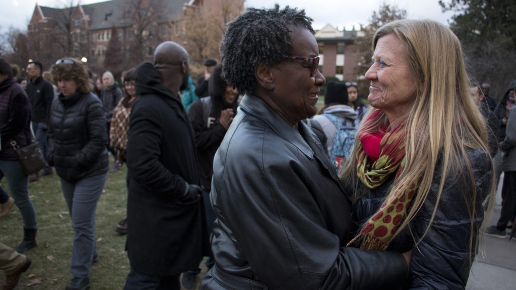 Betsy Hall, assistant dean and professor at Regis University's division of counseling and family therapy, embraces Phyllis Graham-Dickerson after the vigil. Students and faculty at Regis University gather to denounce an incident of hate speech on campus, Nov. 7, 2018. (Kevin J. Beaty/Denverite)