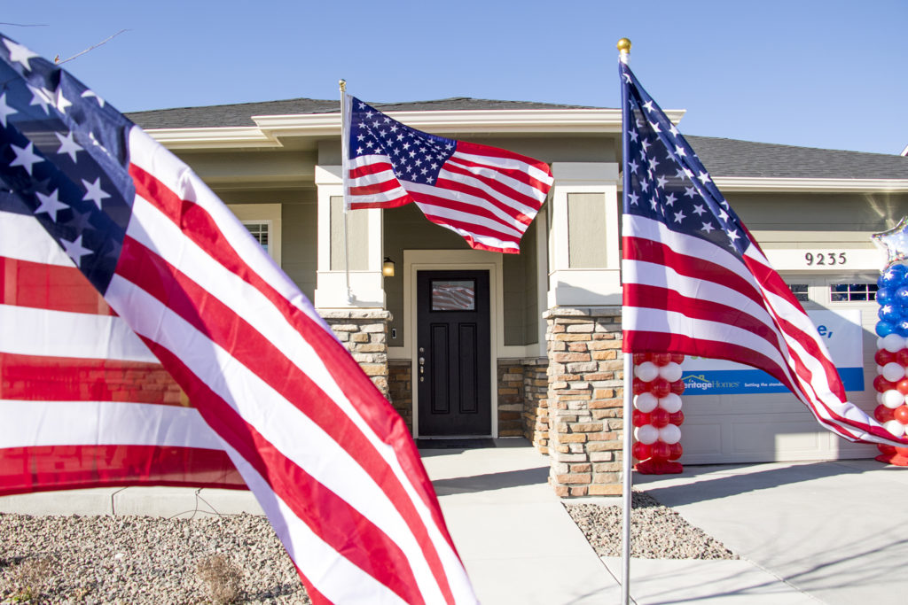 American flags cover Herbert Jackson's new home in Commerce City, Nov. 9, 2018. (Kevin J. Beaty/Denverite)