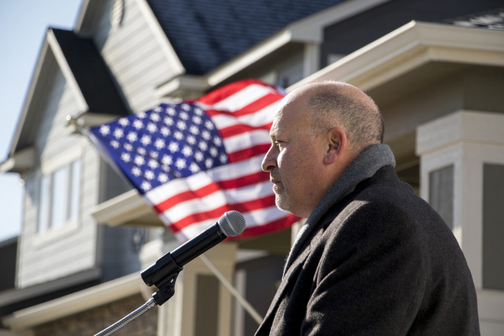Meritage Homes CEO Steve Hilton speaks to a crowd of employees and partners before the Jackson family got to see their new house in Commerce City, Nov. 9, 2018. (Kevin J. Beaty/Denverite)