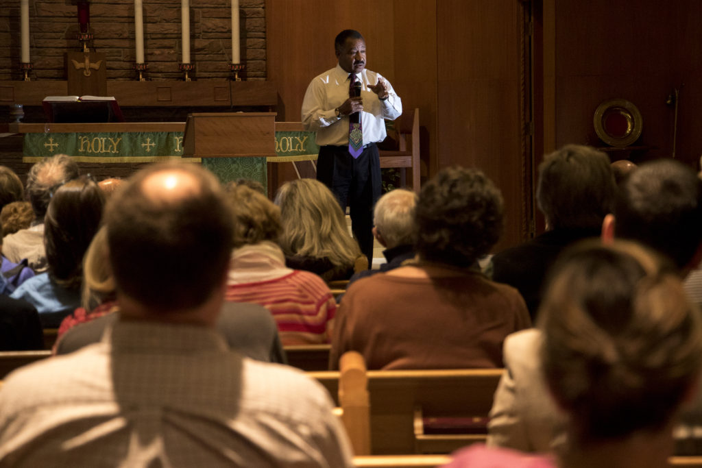 Penfield Tate speaks during a public forum for Denver mayoral candidates at Messiah Community Church in South Park Hill, Nov. 13, 2018. (Kevin J. Beaty/Denverite)