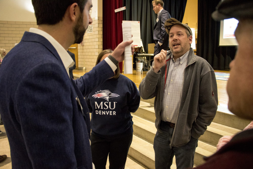 Tim Carl (right) has a heated discussion with CRL Associates partner Sean Malley at a community meeting on the future of the old CDOT headquarters in Virginia Village near Colorado Boulevard, Nov. 16, 2018. (Kevin J. Beaty/Denverite)
