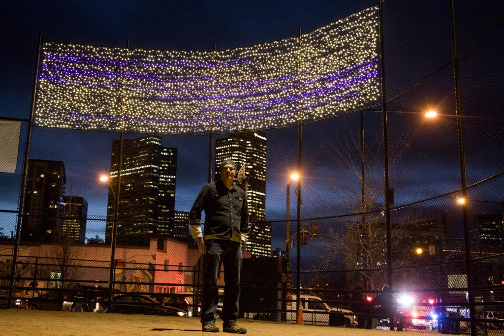 Chris Conner, director of Denver's Road Home, poses in front of lights the organization hung over Sonny Lawson Park, Five Points, Nov. 28, 2018. (Kevin J. Beaty/Denverite)