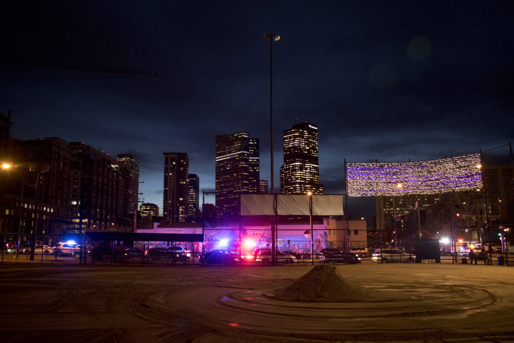 Lights put up above Sonny Lawson Park by Denver's Road Home, Five Points, as police respond to a man who was passed out nearby on the sidewalk, Nov. 28, 2018. (Kevin J. Beaty/Denverite)