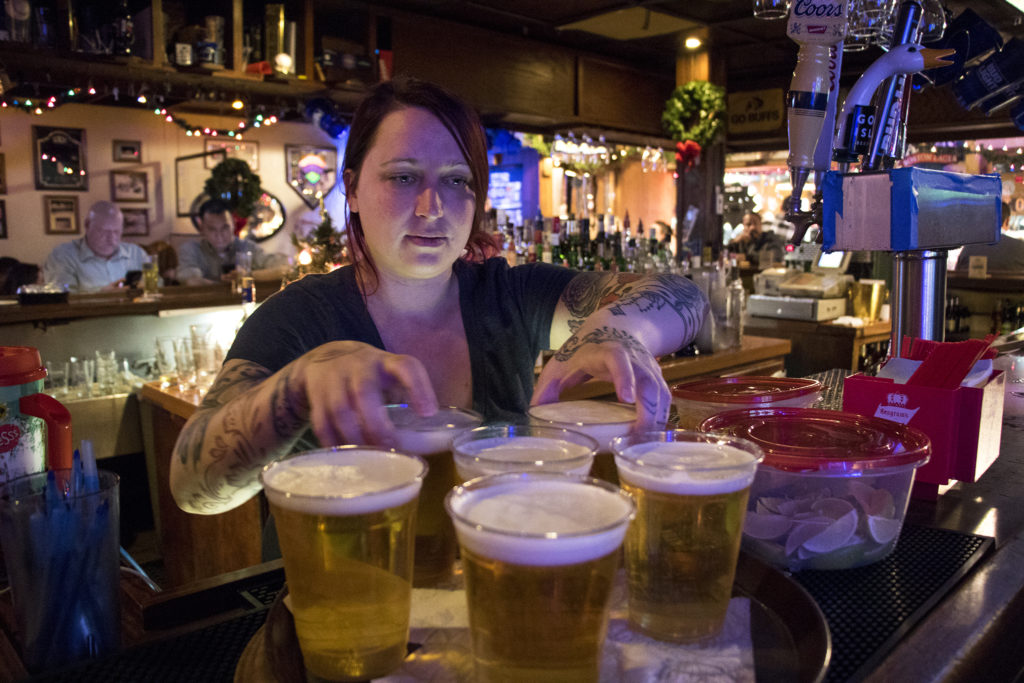 Shae Foust works at Shelby's Bar and Grill on a Thursday. Nov. 29, 2018. (Kevin J. Beaty/Denverite)
