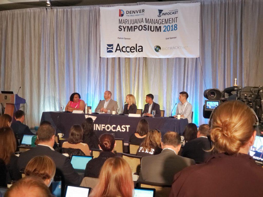 Ashley Kilroy moderates panel during 2018 Marijuana Symposium