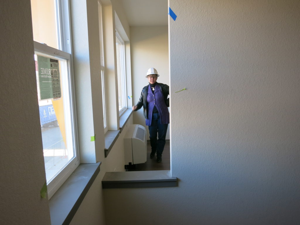 Terrell Curtis, departing leader of The Delores Project, in one of the apartments she has helped develop that will house people who have experienced homelessness. (Donna Bryson/Denverite)