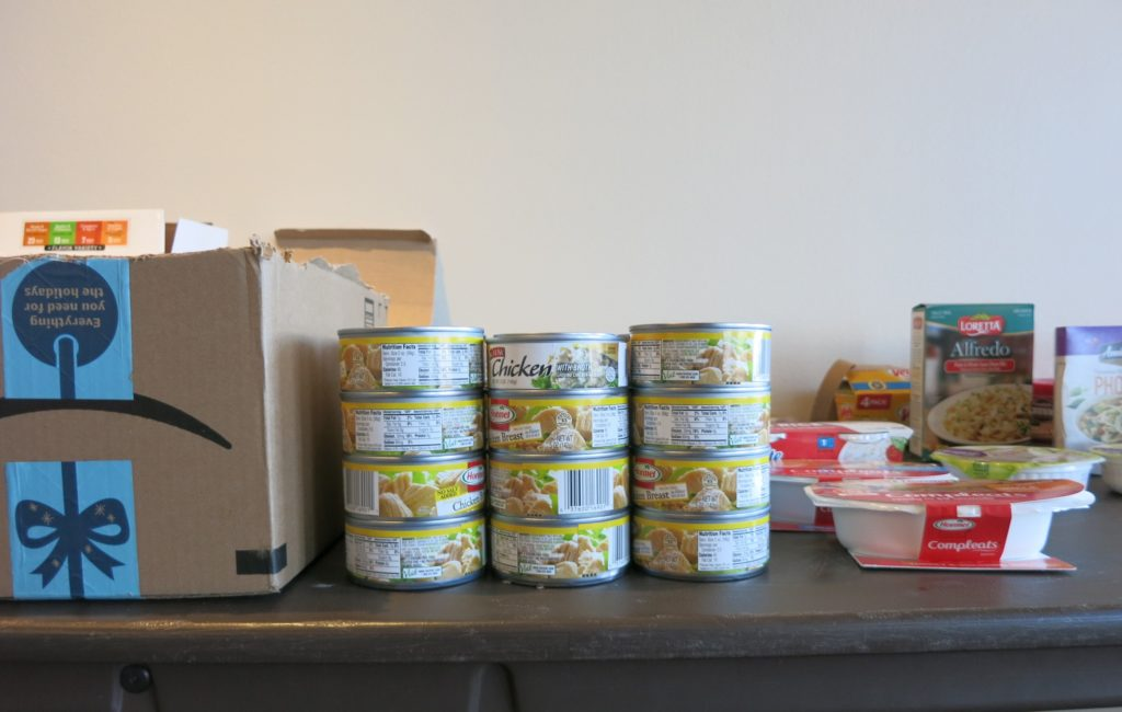 Items on a table of food and toiletries available for needy people during an Auraria campus event on hunger and homelessness among students.