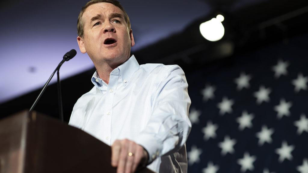 U.S. Sen. Michael Bennet speaks at the Colorado Democratic Party's election night party. (Alyson McClaran for Denverite)