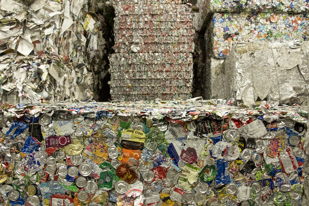 Giant bales of recycled material inside the Altogether Recycling center in Globeville, Dec. 3, 2018. (Kevin J. Beaty/Denverite)