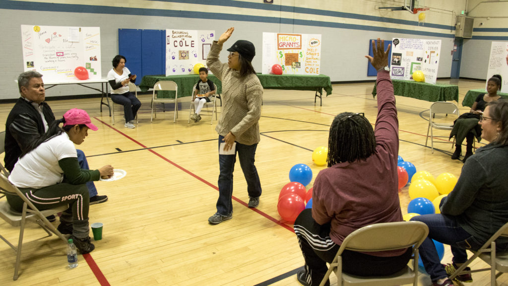 """Cher Chrichlow announces winning ideas in the """"Cole Has A Soul"""" participatory budgeting project during an event at the St. Charles Recreation Center, Dec. 1, 2018. (Kevin J. Beaty/Denverite)"""