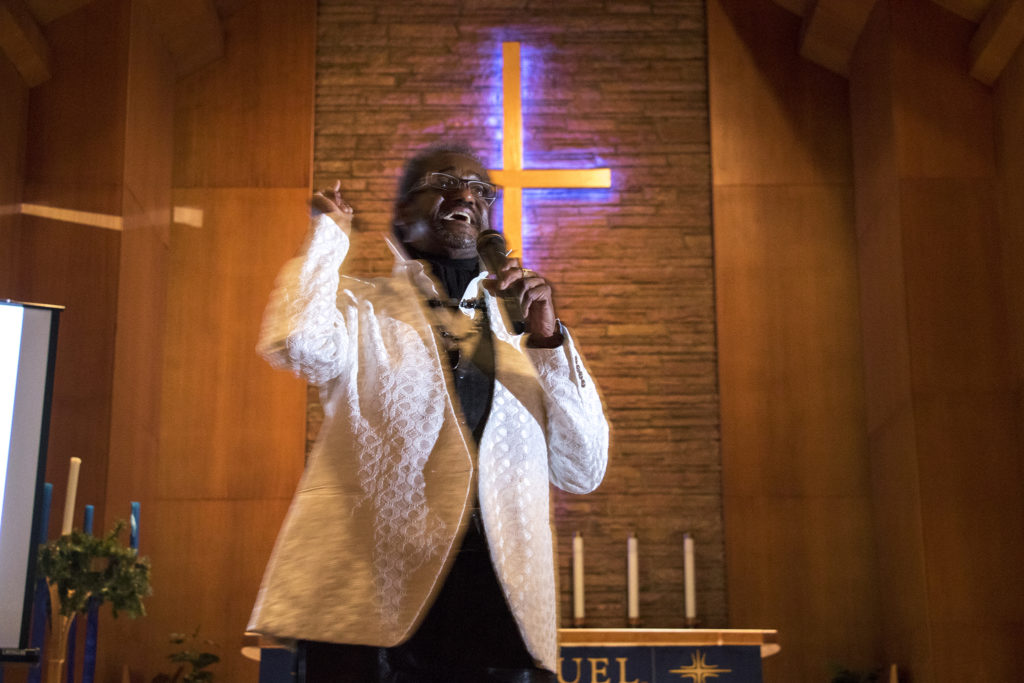 Chairman Seku speaks at City Park Friends and Neighbors' second mayoral candidate forum at Messiah Lutheran Church, Dec. 4, 2018. (Kevin J. Beaty/Denverite)